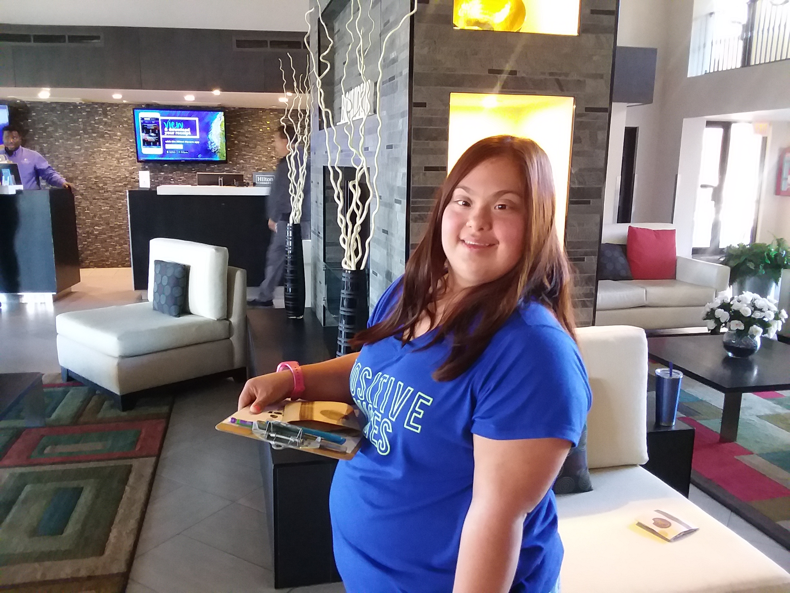 student smiling in hotel lobby