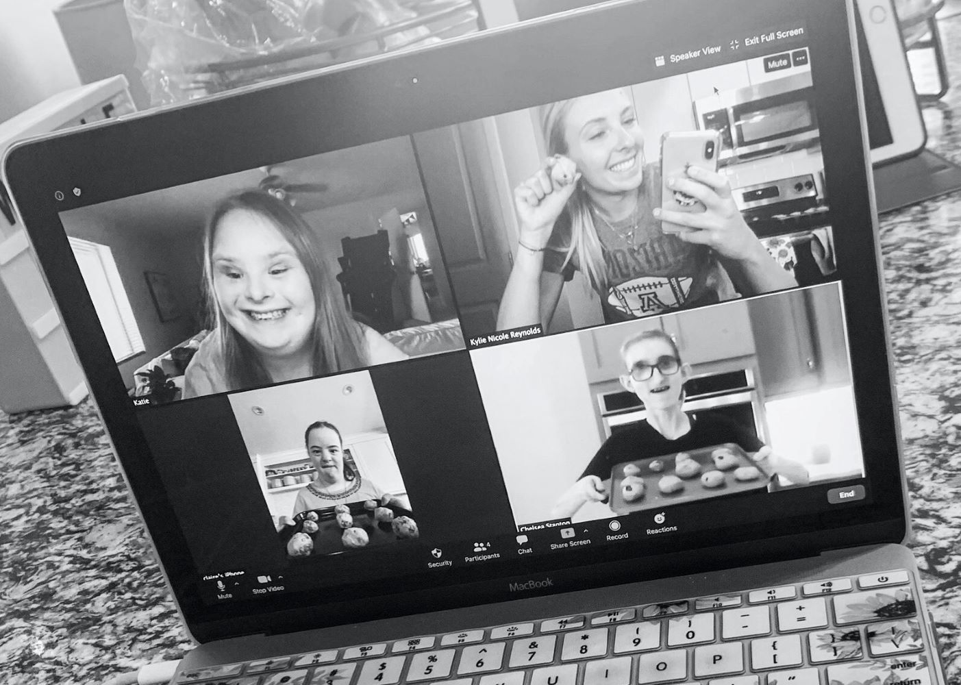 four students sharing their cookies on Zoom