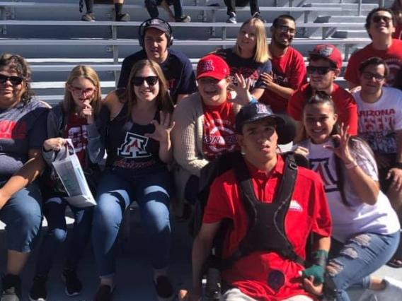 group of students and peer mentors at a football game